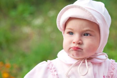 pouty: Baby girl dressed in pink Stock Photo