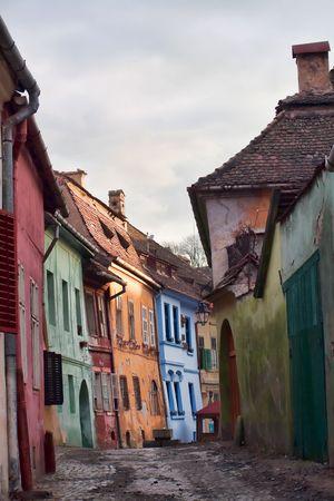 Old medieval street in Sighisoara citadel, Romania
