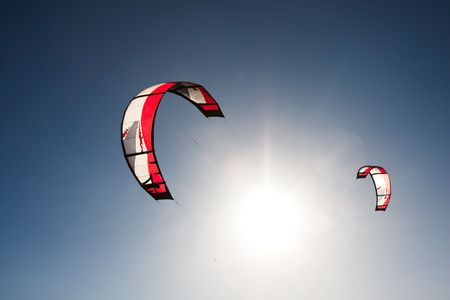 Outdoor kite surfing on a sunny day Stock Photo