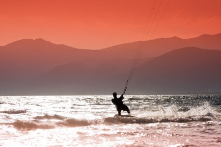 wind surfing: Kite surfers at Skinias beach in Greece.