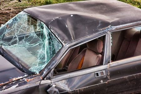 Hood and windshield of a crashed car Stock Photo