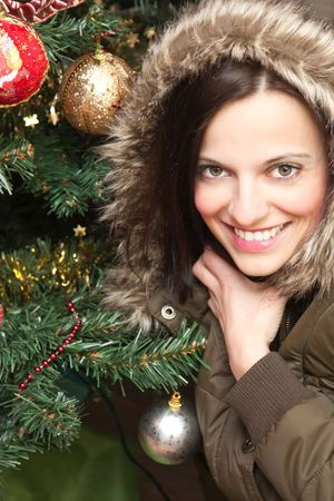 Beautiful brunette portrait sitting by the Christmas tree Stock Photo - 6203632