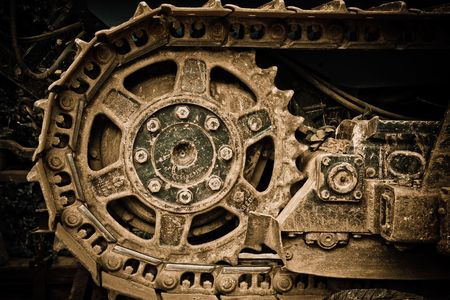 Grunge closeup vista di una ruota buldozer  Archivio Fotografico