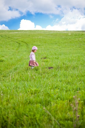 Little girl portrait on a meadow in spring Stock Photo - 6934406