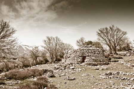 Traditional mitata stone hut in Psiloritis Mountain in Crete, Greece photo
