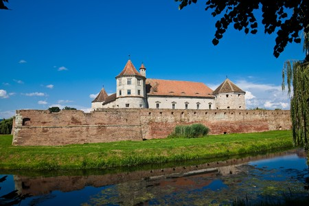 fagaras: The Fagaras Fortress in Brasov County, Romania in summer. Stock Photo