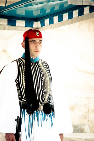 evzones guard: Athens, Greece - February 2010: Evzones sitting on guard in front of the Greek Parliament Editorial