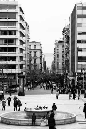 Athens, Greece - February 2010: People walking through Syntagma Square and down to Monastiraki Street.