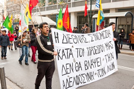 protestors: Athens, Greece - February 2010: Kurdish protestors walking through downtown  with banners Editorial