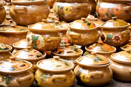 lined up: Various ceramic traditional pottery lined up for sale. Stock Photo
