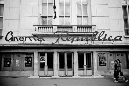 old building facades: IASI, ROMANIA - APRIL 17: The Cinema Republica, one of the still standing communist movie theaters on April 17, 2010 in Iasi, Romania.