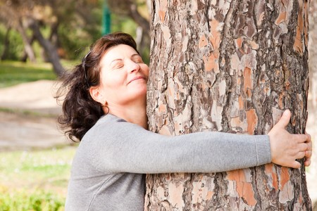 Portrait of a middle aged woman enjoying a spring day outdoor. photo