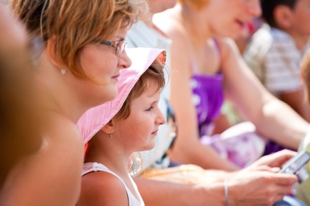Mother and daughter enjoying the show at the dolphinarium. Stock Photo - 7729530