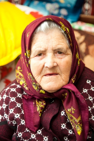 no face: Portrait of an old Romanian woman in her home.