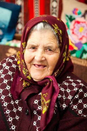 no people: Portrait of an old Romanian woman in her home.