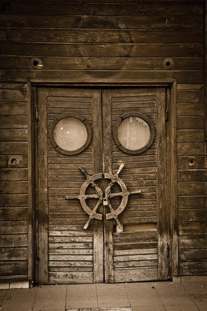 view of a wooden doorway: Old wooden door on an abandoned boat, vintage style. Stock Photo