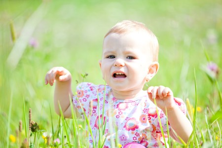 Baby girl spending time outdoor on a summer day. Stock Photo - 8035019