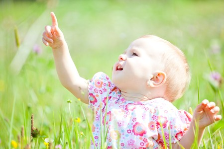 Baby girl spending time outdoor on a summer day. photo