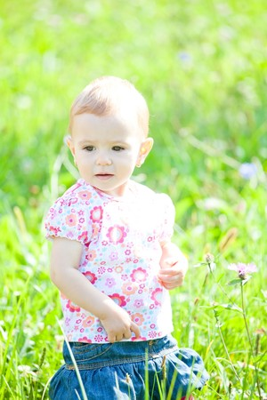 Baby girl spending time outdoor on a summer day. Stock Photo - 8035026