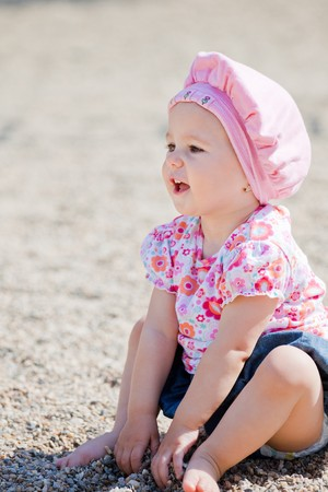 Small baby girl spending time outdoor on a warm autumn day. Stock Photo