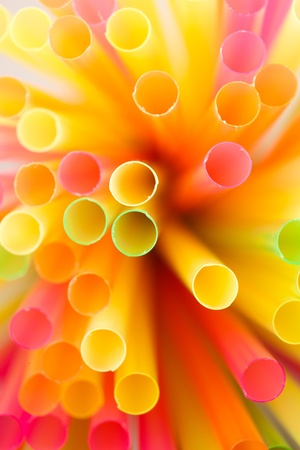 Close up of many colorful drinking straws. photo