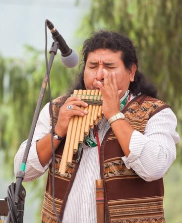 panpipe: BICAZ, ROMANIA - AUGUST 17: Member of the Des Los Andes band playing at the pan-pipe on August 17, 2010 in Bicaz, Romania. Editorial