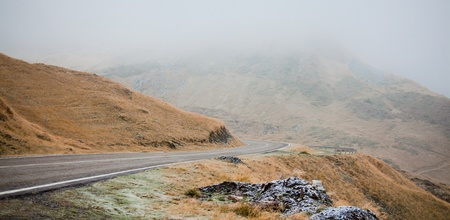Panoramic view Transfagarasan Highway which crosses Fagarasi Mountains at 2000 m altitude in autumn during the first snow, Romania photo