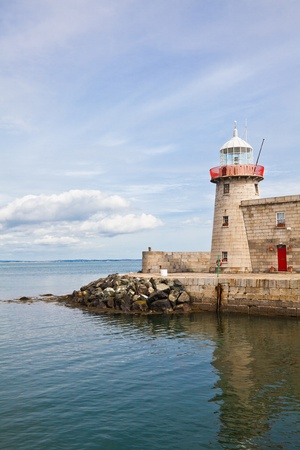 vertical orientation: Howth lighthouse in county Dublin, Ireland. The lighthouse was built in 1817.