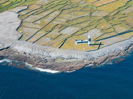 aran islands: Aerial landscape of the lighthouse on  Inisheer Island, part of Aran Islands, Ireland. Stock Photo