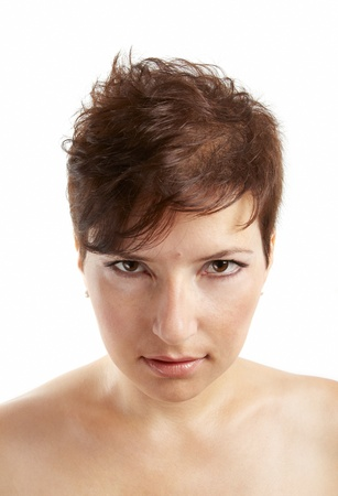 Portrait of a young woman with a modern haircut and bare shoulders studio shot. photo