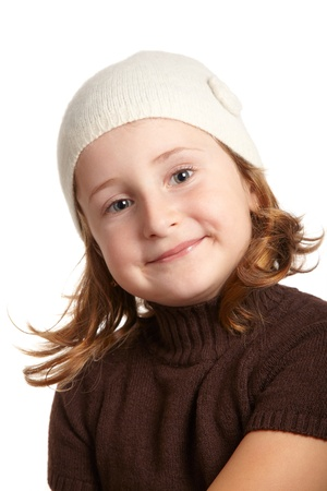 Portrait of a little girl smiling isolated on white background. photo