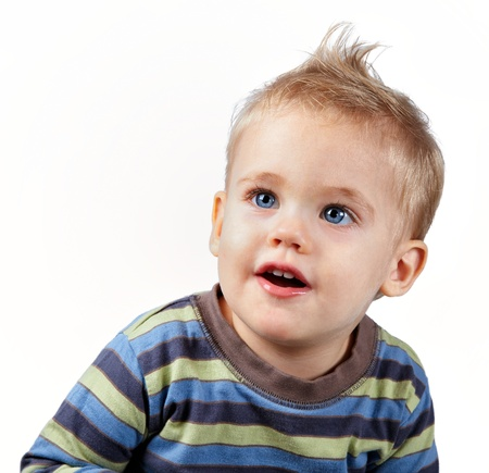 Studio portrait of a happy one year old baby boy on white.