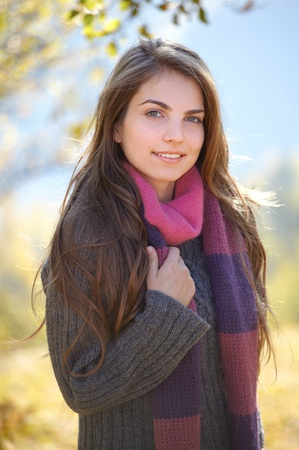 Portrait of a young woman on a chilly sunny day of autumn outdoor. Stock Photo - 11313518
