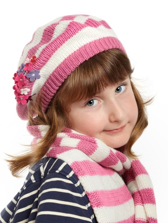 Cute little girl wearing pink hat and scarf smiling isolated on white background. photo