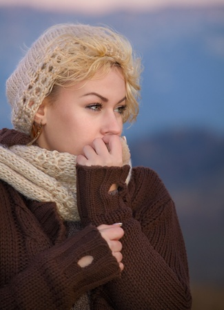 Portrait of a young woman as evening falls in autumn cold. Stock Photo - 11313529