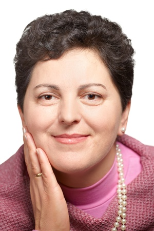 40 year old: Portrait of a beautiful middle aged woman against a white background. Stock Photo