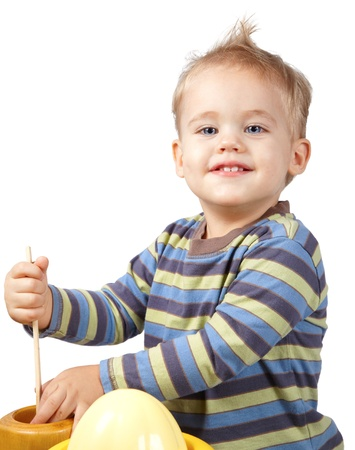 Studio portrait of a happy one year old baby boy playing with kitchen utensils. Stock Photo - 11313551