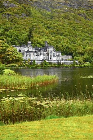 Overcast view of Kylemore Abbey in summer, Ireland. Stock Photo