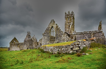 Overcast landscape of Ross Friary in summertime, Ireland.