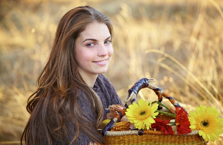 20 year old: Portrait of a beautiful 20 year old young woman outdoor during autumn season. Stock Photo