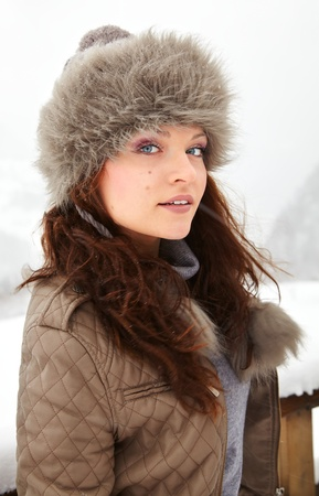 20 year old: Headshot of a beautiful 20 year old young woman enjoying winter outdoor. Stock Photo