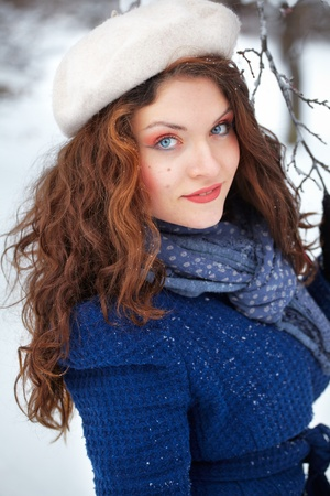 Headshot of a beautiful 20 year old young woman enjoying winter outdoor. Stock Photo - 12155972