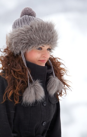 20 year old: Portrait of a beautiful 20 year old woman outdoor in winter dressed elegant. Stock Photo
