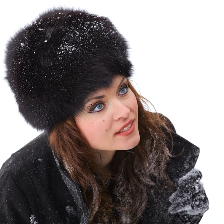 20 year old: Portrait of a beautiful 20 year old woman dressed elegant, outdoor in winter. Stock Photo