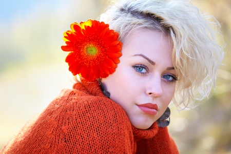 Portrait of a beautiful 20 year old woman outdoor in autumn.