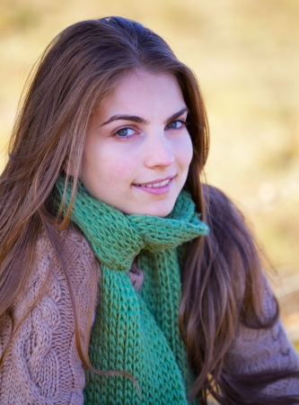 20 year old: Portrait of a 20 year old woman outdoor in autumn. Stock Photo