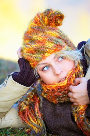 Young woman portrait while outdoor and smiling in autumn. photo