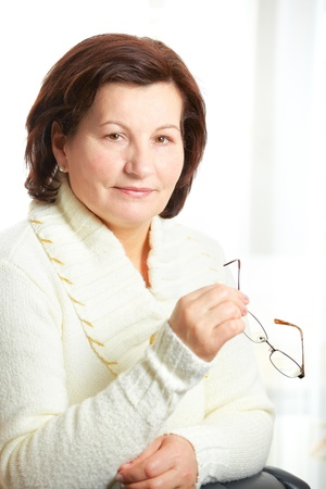 fifty: Beautiful middle aged business woman portrait at the office.