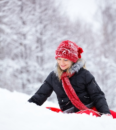 Woman in her 30s enjoying the snow in the countryside. photo