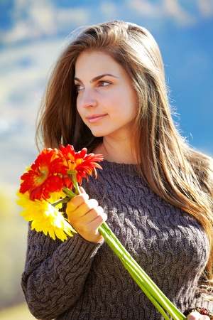 20 year old girl: Beautiful brunette with long hair spending a day outdoor in the countryside. Stock Photo